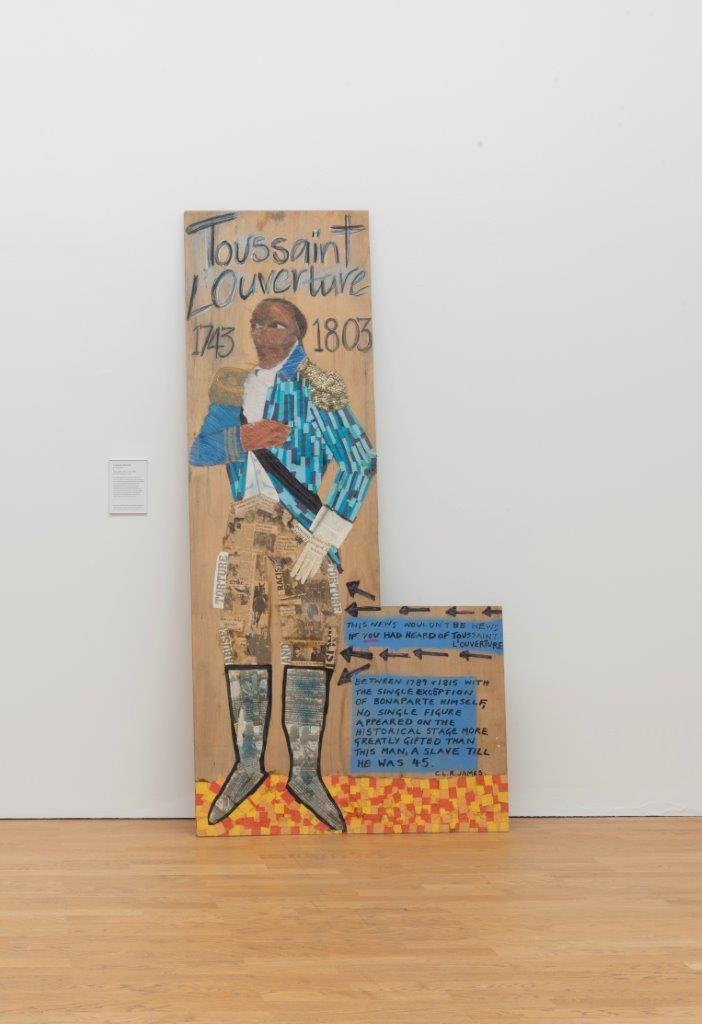 Lubaina Himid, 'Toussaint L'Ouverture', (1987). Himid depicts a man in smart military costume in a heroic stance, with a quotation reading: This NEWS WOULDN'T BE NEWS IF YOU HAD HEARD OF TOUSSAINT L'OUVERTURE. BETWEEN 1789 & 1815 WITH THE SINGLE EXCEPTION OF BONAPARTE HIMSELF, NO SINGLE FIGURE APPEARED ON THE HISTORICAL STAGE MORE GREATLY GIFTED THAN THIS MAN, A SLAVE TILL HE WAS 45. C.L.R. JAMES