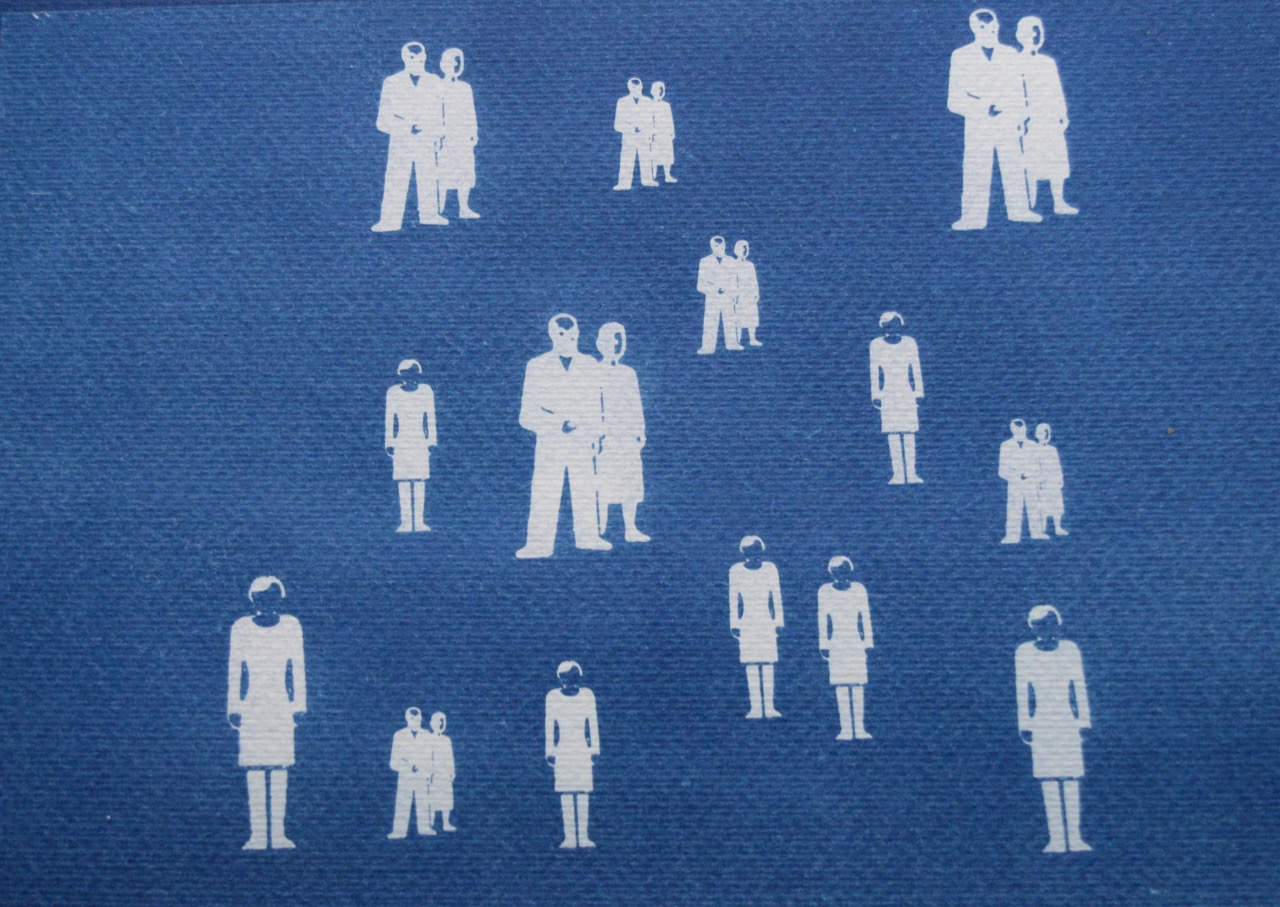 A blue cyanotype print with white silhouettes of figures- some stood in pairs and others individually.