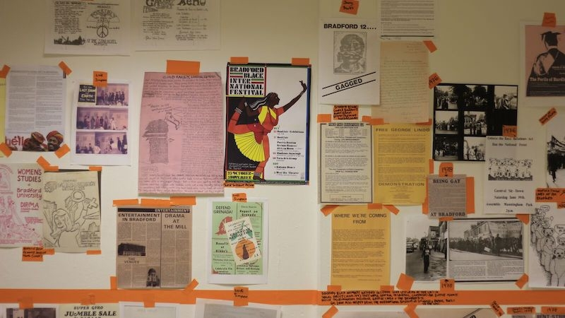 a wall with timeline and pasted materials