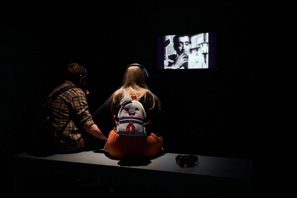 Image showing people watching Tessa Norton's film work.