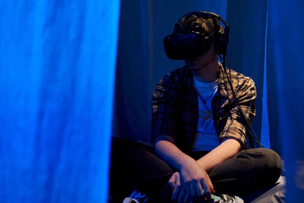 Image showing a visitor in a VR headset experiencing Yambe Tam's work.